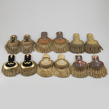 Six pair of swedish epaulettes in boxes.
