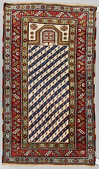 A RUG, a semi-antique Caucasian, a prayer rug, ca 160,5-165 x 96,5 cm (as well as 1 cm flat weave at the ends).