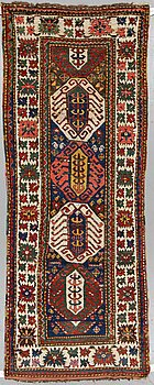 A RUNNER, a semi-antique Kazak, ca 273-277 x 100-105 cm (as well as ca 2,5 cm flat weave at one end).