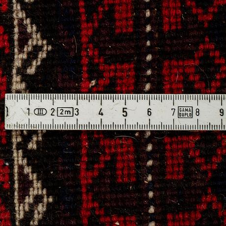 A rug, semi-antique baluch, ca 192 x 81 cm.