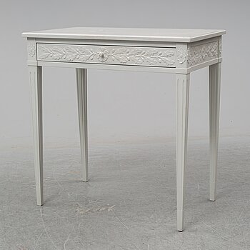 A late Gustavian style table with a drawer from around year 1900.