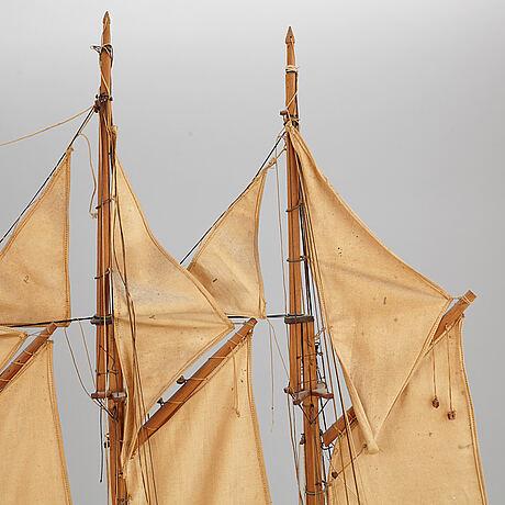 A early 20th century model ship.