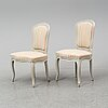 A mid 18th century matched pair of rococo chairs.