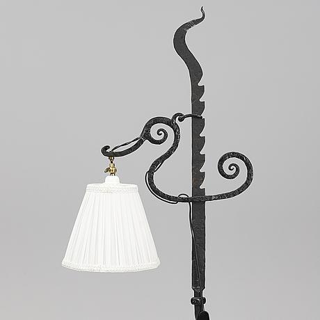 An iron floor lamp.