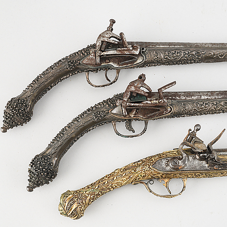A pair of miquelet pistols and an flintlock pistol, 18/19th century.