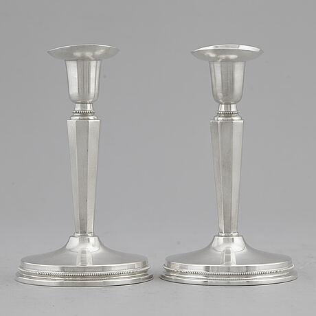 Eric lÖfman, a pair of silver candlesticks, mgab, uppsala, 1955.