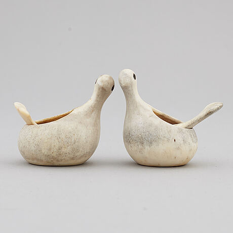 Lars pirak, two reindeer horn grouse salt cellars, signed.