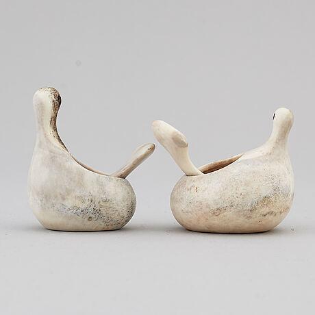 Lars pirak, two reindeer horn grouse salt cellars, signed.