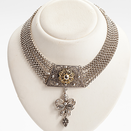 A silver necklace.