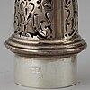 A silver sugar shaker.