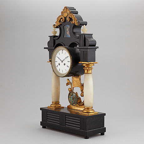 A late empire table clock, mid 19th century.