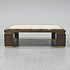 A travetine and brass sofa table, 1970s, probably belgo chrome.