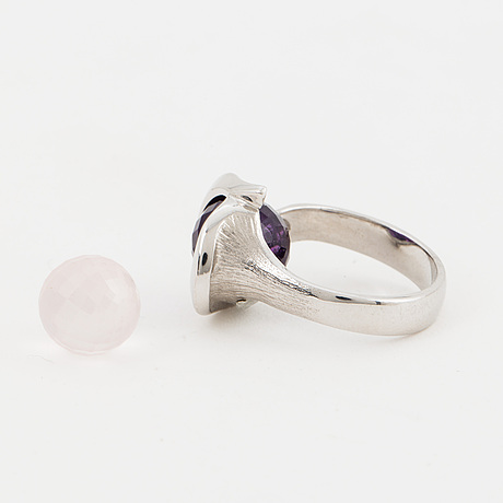 """Per borup, a """"changeline"""" ring with amethyst and rosequartz beads."""