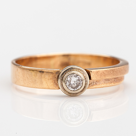 A 14k gold ring with a ca. 0.10 ct diamond. russia.