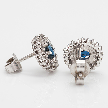 A pair of 14k white gold earrings with sapphires and diamonds ca 0.05 ct in total.