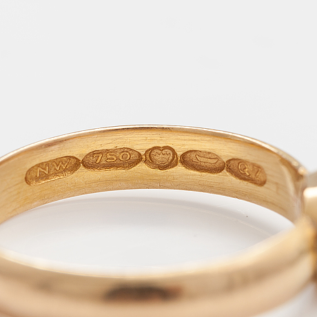 Ring, 18k guld, granat. westerback, helsingfors 1969.