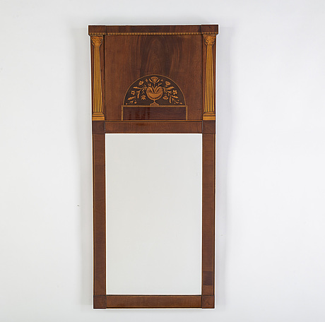A 20th century mahogany mirror.
