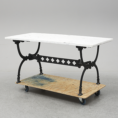 An end of the 20th century aluminum and marble garden table.