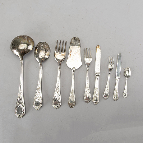 A 64 pieces set of 800 silver and silverplate italian cutlery. total weight incl steel blades app. 2400 gram.