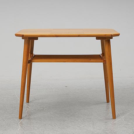 A swedish modern elm wood coffee table.