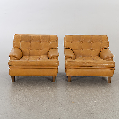 "Arne norell, a pair of ""mexico"" norell ab lounge chairs."