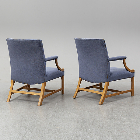 A mid 20th century pair of oak armchairs attributed to carl malmsten.