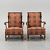 A pair of 1920s easy chairs.