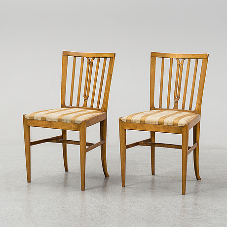 A pair of model 2095 chairs by carl malmsten, nordiska kompaniet.