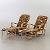A pair of second half of the 20th century loungechairs with stools.