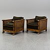 A pair of swedish modern, 1930s/1940s easy chairs.