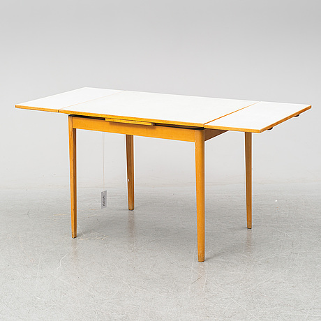 A mid 20th century dining table.