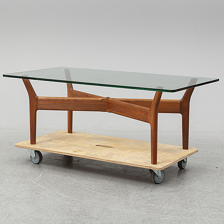 Alf svensson, a teak and glass coffee table, mid 20th century.