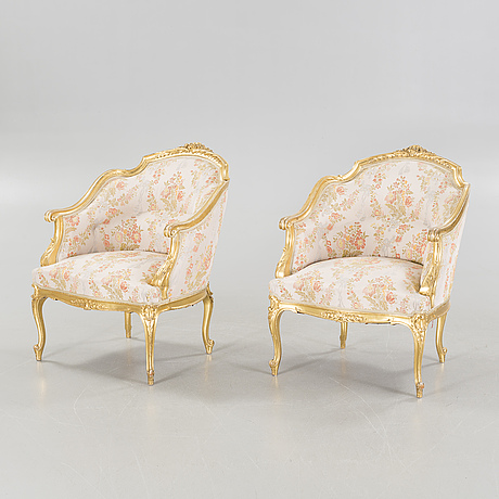 A pair of rococo style bergères, late 19th century.