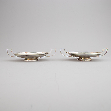 A pair of sterling silver tazzaz.
