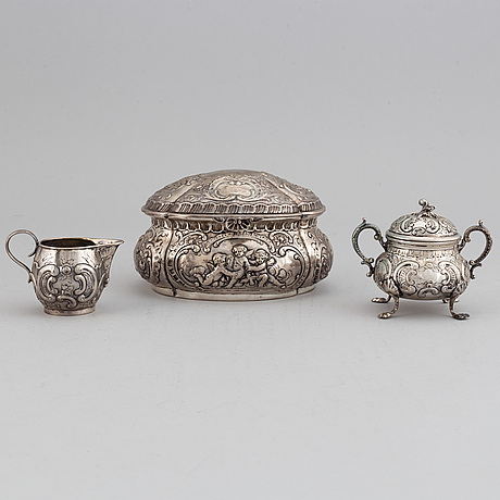 A german silver 800 sugar box, creamer and sugar bowl.
