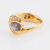 Olle ohlsson, 18k gold ring with star sapphire and diamonds.
