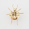 A brooch, in 18k gold and yellow metal.