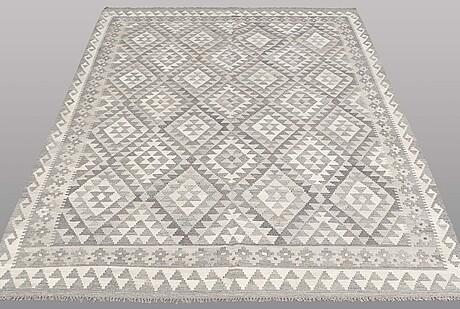 A carpet, kilim, ca 242 x 178 cm.