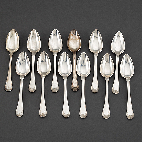 A swedish set of eleven + 1 silver dessert-spoons, mark of anders lundqvist, stockholm 1829.