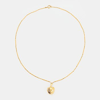 402. An 18K gold necklace in the form of an apple set with old-cut diamonds.