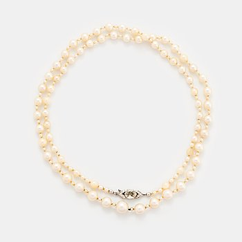 403. A cultured pearl necklace with a WA Bolin clasp.