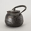 A japanese iron tea pot with bronze cover, signed.