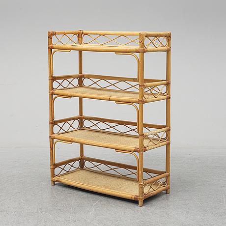 A late 20th century rattan shelf.