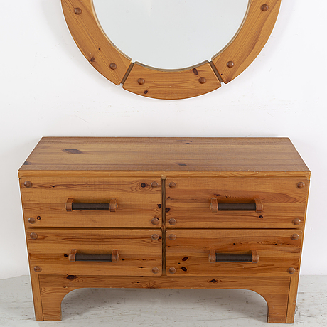 A 1970's set with a pine mirror and chest of drawers.