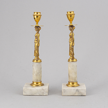 A pair of gustavian style candle holders, late 19th/early 20th century.