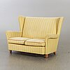 A 1940:s sofa in yellow striped fabric.