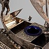 A silver plated inkwell, circa 1900.