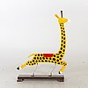 A second half of the 20th century rocking giraffe.