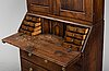 An early 19th century pine cabinet.
