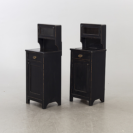 A pair of first half of the 20th century bedside tables.